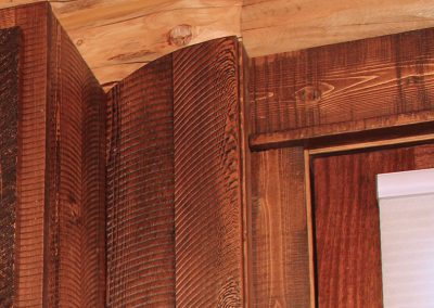 Unique Textured Rustic Wood Trim Joining Door and Cabinet